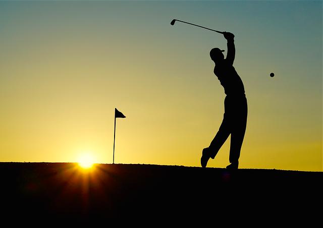 příznivec golfu